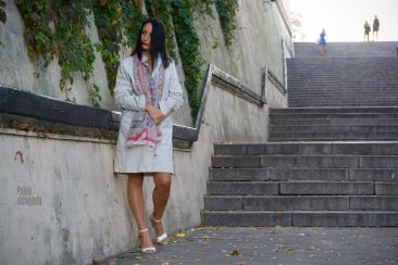 Girl in a raincoat on a naked body posing on the steps. Pablo Incognito