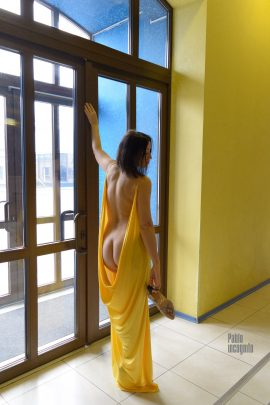 Nude woman posing near the window. Bare back and butt. Nude photo by Pablo Incognito