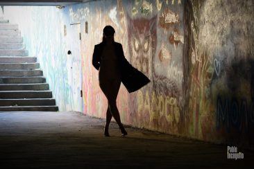 Silhouette of a girl in an underpass. Nude photoshoot by Pablo Incognito