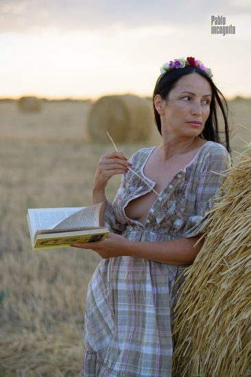 The girl in the hay poses for the photographer. Glamor, nude. She unbuttoned her dress. Nude photo by Pablo Incognito