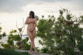 A completely naked woman on a deserted island. Naked landing. Nude photo by Pablo Incognito
