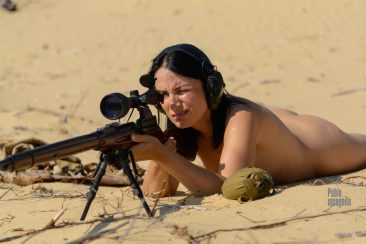 Naked girl sniper with a rifle in the desert. Nude photo by Pablo Incognito