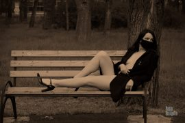 Naked girl in the park on the bench. Nude photo by Pablo Incognito