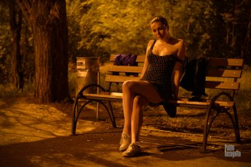 The girl is flirting. Posing in the park at night on a bench. Nude photo by Pablo Incognito