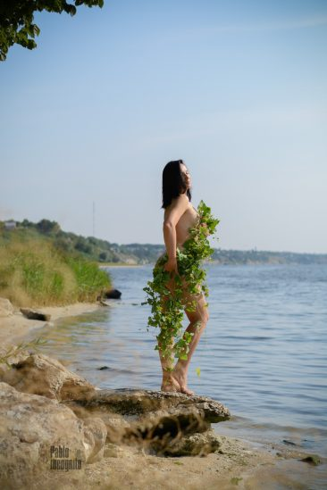 The naked goddess covered herself with ivy on the river bank. Nude photo by Pablo Incognito