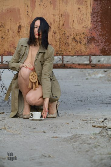 Nude model Iren Adler in a raincoat on a naked body poses for photographer Pablo Incognito