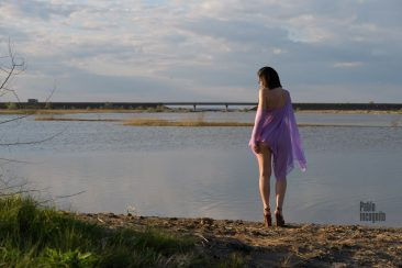 A girl in a transparent poncho on the bank of the estuary. Nude photo by Pablo Incognito