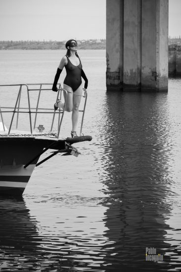 Black and white nude. A girl in a transparent bodysuit on the bow of the yacht. Photo by Pablo Incognito