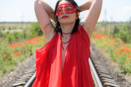 Naked girl in a mask posing on the rails. Nude photo by Pablo Incognito
