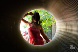 Girl posing in the tube. Topless photo. Pablo Incognito