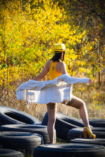 Girl posing bottomless on car tires. In stockings and no panties. Photoshoot in the autumn park. Nude photo by Pablo Incognito