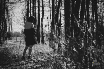 А half-naked girl in a black forest. Nude photo by Pablo Incognito