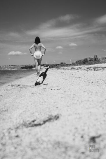 Nude photoshoot on a wild beach. Wine bottle and spicy footage. Photographer Pablo Incognito