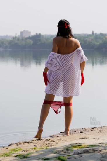 A girl with her panties down on the river bank. Photo by Pablo Incognito