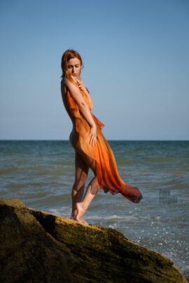 Redhead girl posing nude on a wild beach. Photographer Pablo Incognito