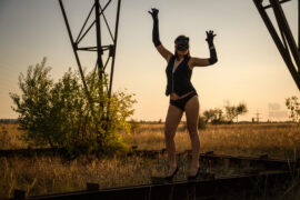 Cat woman in a nude photo session near the power line. Photo by Pablo Incognito