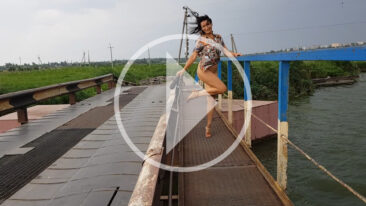 Bottomless video. Nude on the bridge. The wind lifts the short dress. Nude photographer Pablo Incognito