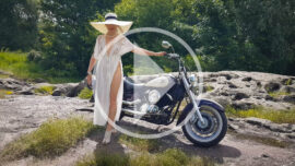 Semi-nude Iren Adler in a peignoir with a motorcycle. Video by Pablo Incognito