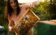 Naked girl with honeycombs in the apiary. Photo of nude Pablo Incognito